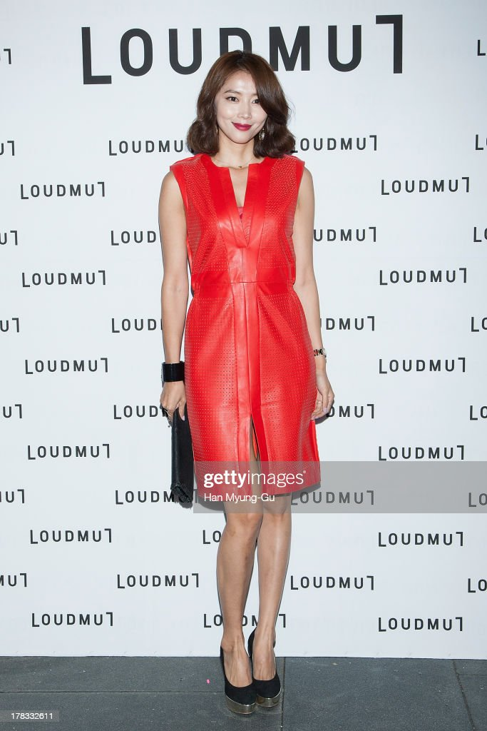 South Korean actress <a gi-track='captionPersonalityLinkClicked' href=/galleries/search?phrase=Oh+Yoon-Ah&family=editorial&specificpeople=4341554 ng-click='$event.stopPropagation()'>Oh Yoon-Ah</a> attends during the 'Loudmut' launching fashion show at the JNB gallery on August 29, 2013 in Seoul, South Korea.
