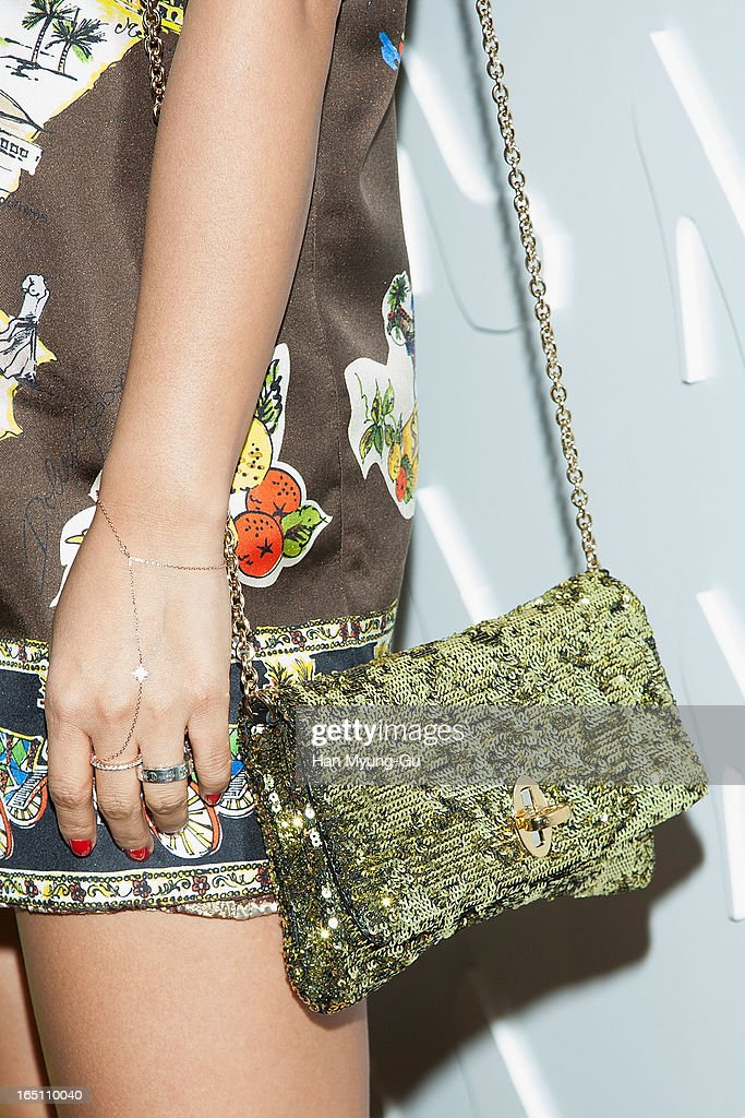 South Korean actress Uhm Jung-Hwa (handbag detail) attends the 'Suecomma Bonnie' 10th Anniversary Exhibition at Conrad Hotel on March 29, 2013 in Seoul, South Korea.