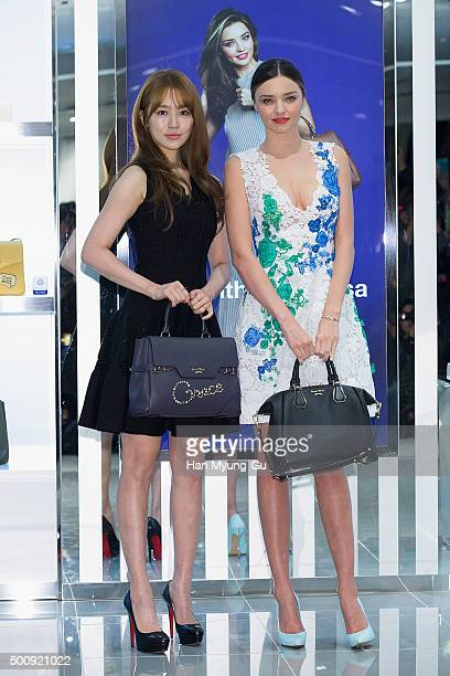 South Korean actress Yoon EunHye and Miranda Kerr attend the photo call for 'Samantha Thavasa' at Lotte Department Store on December 11 2015 in Seoul...