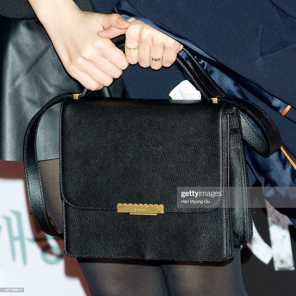 South Korean actress Yoon Ji-Ni (handbag detail) attends the 'Psychometry' VIP Screening at CGV on February 26, 2013 in Seoul, South Korea. The film will open on March 07 in South Korea.