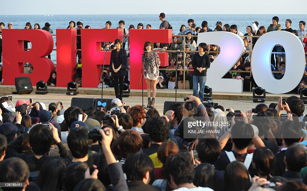 South Korean actresses Nam Ji-Hyun (L) and Song Hye-Kyo (C) and director Lee Jeong-Hyang (R) attend the greeting event for the film 'A Reason to live' during the Busan International Film Festival (BIFF) on October 8, 2011 AFP PHOTO / KIM JAE-HWAN