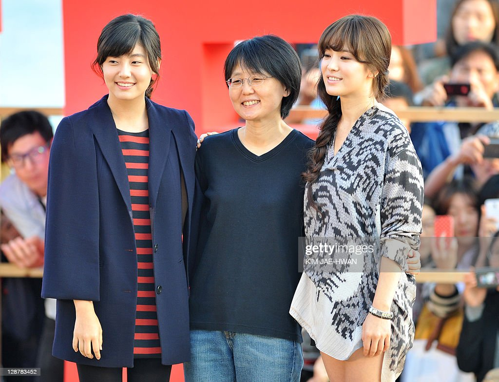 South Korean actresses Nam Ji-Hyun (L) and Song Hye-Kyo (C) and director Lee Jeong-Hyang (R) attend the greeting event for the film 'A Reason to live' during the Busan International Film Festival (BIFF) on October 8, 2011
