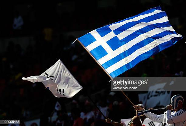 South Korean and Greek flags are waved ahead of the 2010 FIFA World Cup South Africa Group B match between South Korea and Greece at Nelson Mandela...