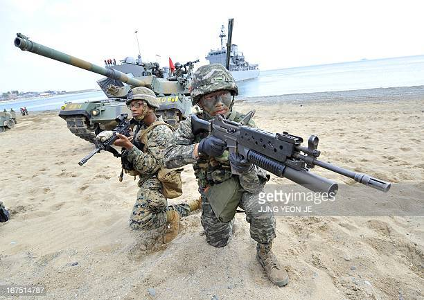 South Korean and US Marines take a position on the seashore during a joint landing operation by US and South Korean Marines in Pohang 270 kms...