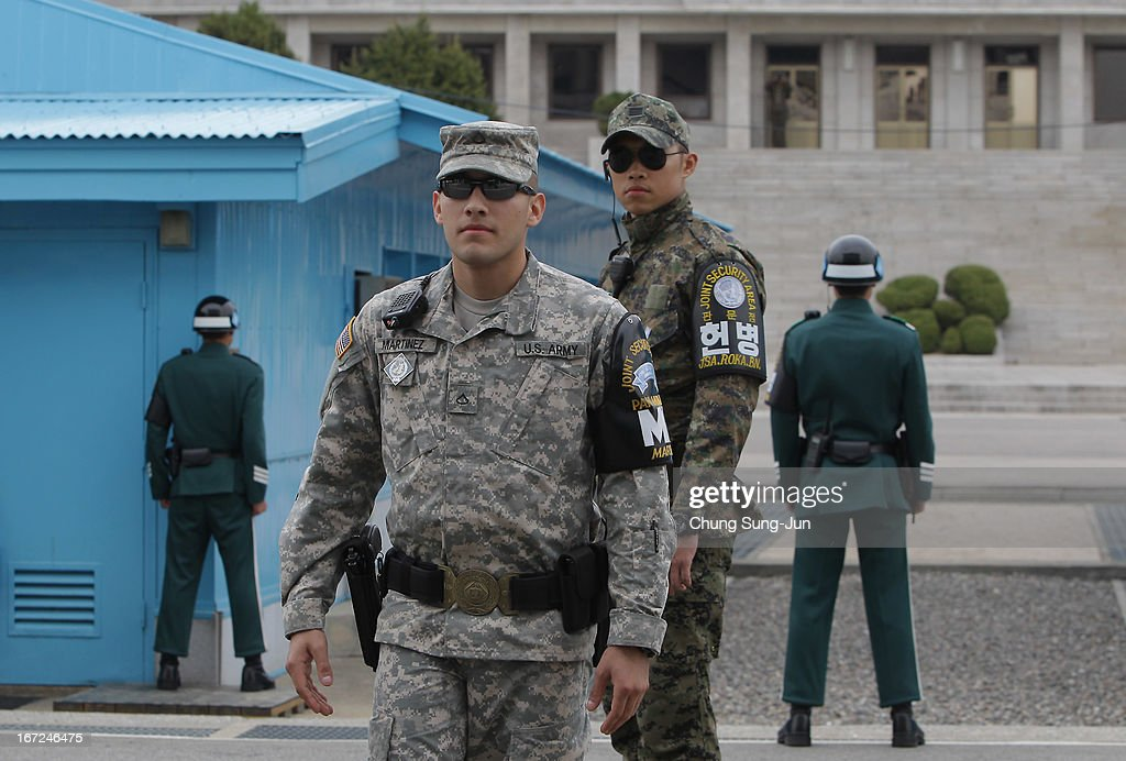 South Korean and US soldiers stand guard at the border village of Panmunjom between South and North Korea at the Demilitarized Zone (DMZ) on April 23, 2013 in Panmunjom, South Korea. The tension at Korean Peninsula remains high as North Korea's ballistic missiles have been ready to launch ahead of North Korean Army foundation celebration day on April 25.
