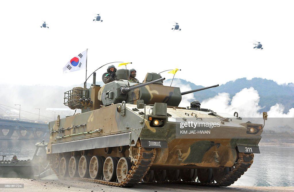 South Korean anti-aircraft armoured vehicles move over a temporary bridge during a river-crossing military drill in Hwacheon near the border with North Korea on April 1, 2013. South Korea's new president promised a strong military response to any North Korean provocation after Pyongyang announced that the two countries were now in a state of war.