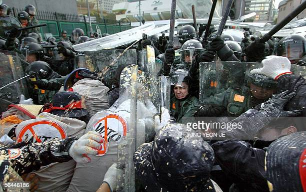 South Korean antiglobalization demonstrators clash with riot police during a demonstration against the sixth World Trade Organization ministerial...