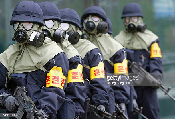 South Korean armed policeman participate in an antiterror drill near the Seoul railroad station on September 6 2005 in Seoul South Korea About 500...