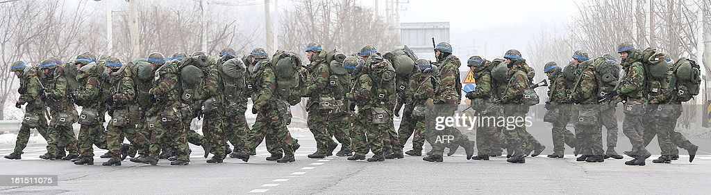 South Korean armed soldiers march during a military field exercise in Paju near the demilitarized zone dividing the two Koreas on February 12, 2013. North Korea on February 12 staged its most powerful nuclear test yet, claiming a breakthrough with a 'miniaturised' device in a striking act of defiance that drew condemnation from global powers including its sole patron China. REPUBLIC OF KOREA OUT AFP PHOTO/DONG-A ILBO