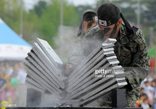 South Korean army commandos smash a pile of stone plates in a show of force at the national war museum in Seoul on May 5 2010 marking children's day...