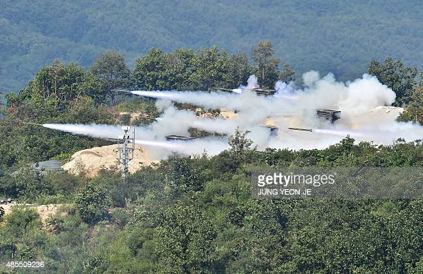 South Korean Army multiple rocket launch system launch rockets duirng a joint live firing drill with the US at the Seungjin Fire Training Field in...