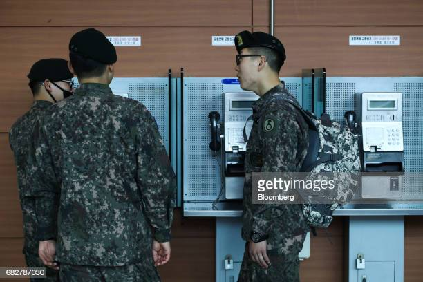 South Korean army soldiers chat in front of public phones at Seoul Station in Seoul South Korea on Sunday May 14 2017 North Korea fired a ballistic...