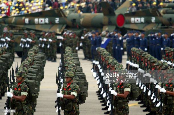 South Korean army soldiers salute during the 55th Armed Forces Day ceremony at the Sungnam military airport October 1 2003 in Sungnam South Korea...