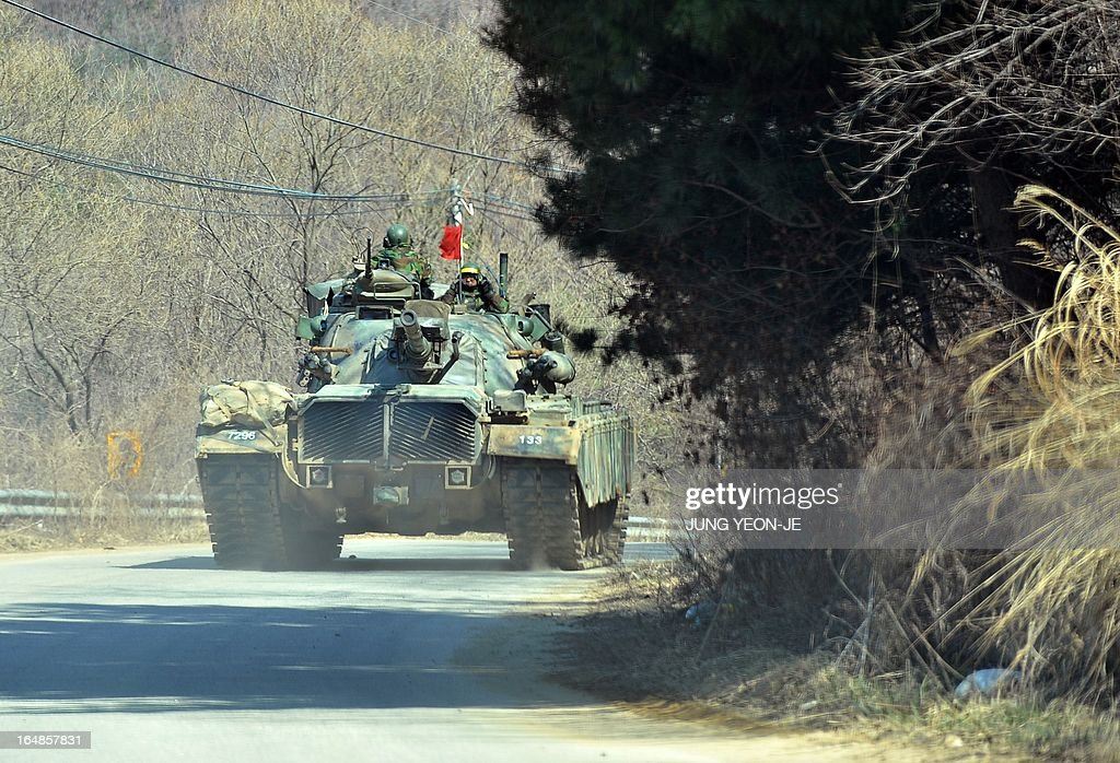 A South Korean army tank drives on a road near a military training field in the border city of Paju on March 29, 2013. North Korean leader Kim Jong-Un ordered preparations on March 29 for strategic rocket strikes on the US mainland and military bases after US stealth bombers flew training runs over South Korea. AFP PHOTO / JUNG YEON-JE