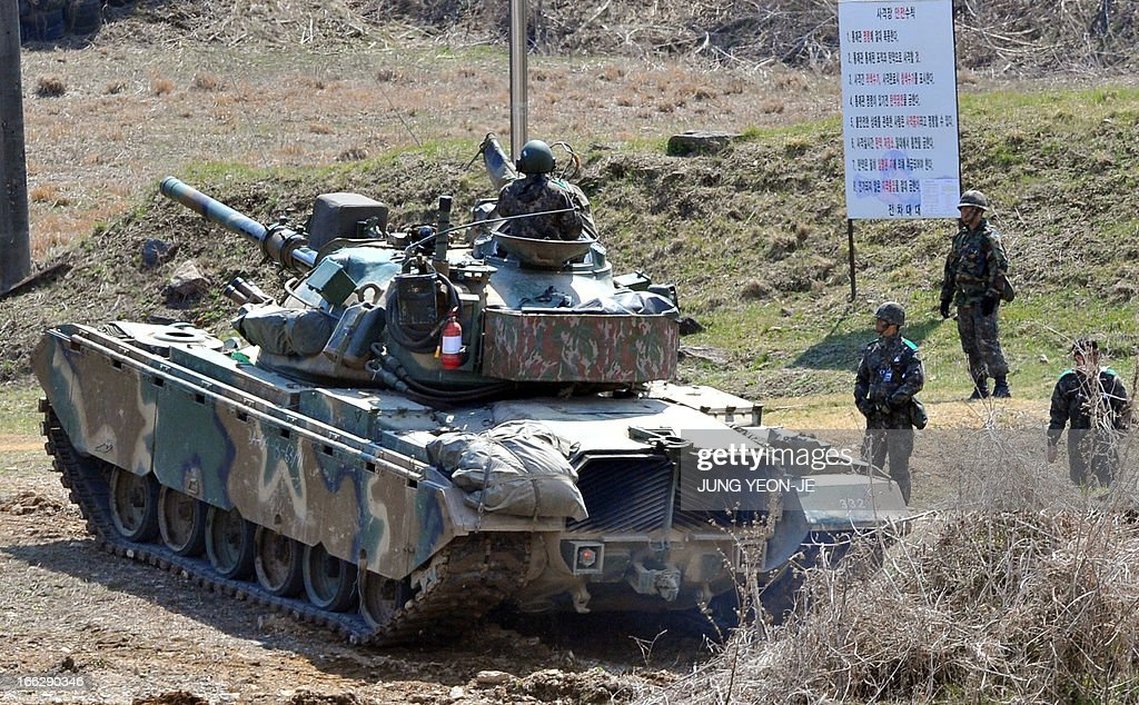 A South Korean army tank moves at a shooting range in the border city of Paju on April 11, 2013. North Korea kept the world on edge on April 11, over an expected missile launch while turning its own energies to celebrating leaders past and present amid soaring tensions on the Korean peninsula.