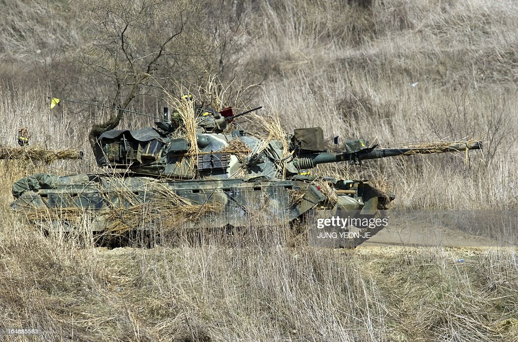 A South Korean army tank participates in a drill at a military training field in the border city of Paju on March 29, 2013. North Korean leader Kim Jong-Un on March 29, ordered missile units to prepare to strike US mainland and military bases, vowing to 'settle accounts' after US stealth bombers flew over South Korea. AFP PHOTO / JUNG YEON-JE