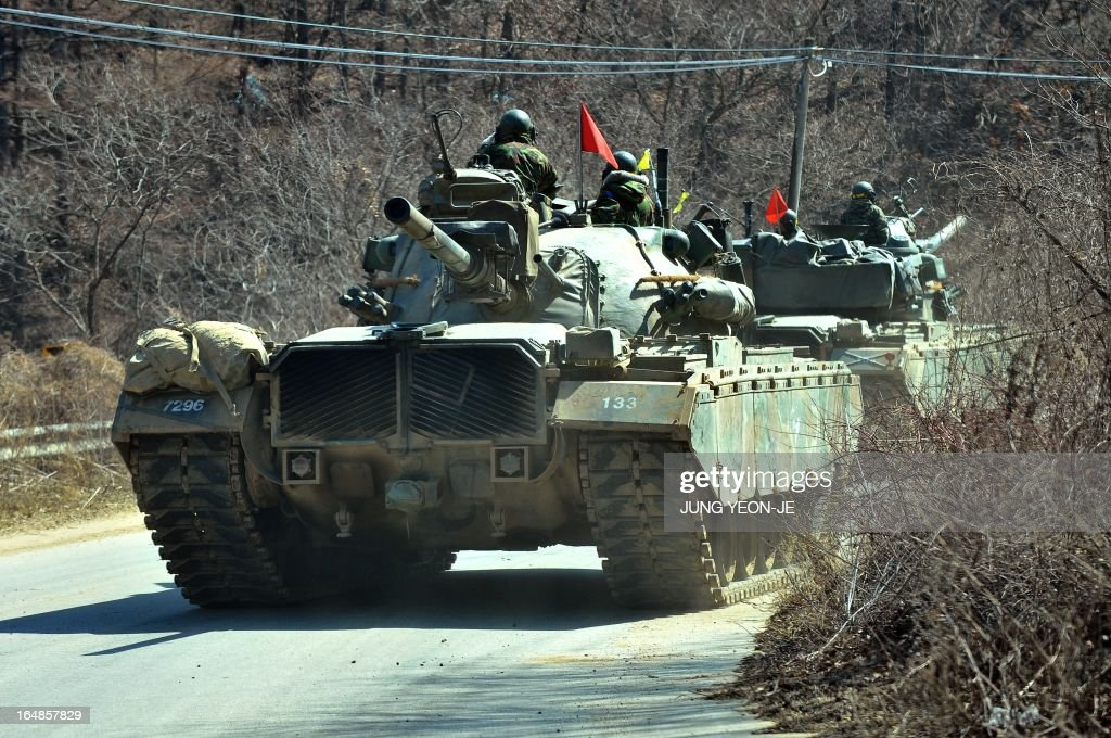 South Korean army tanks drive on a road near a military training field in the border city of Paju on March 29, 2013. North Korean leader Kim Jong-Un ordered preparations on March 29 for strategic rocket strikes on the US mainland and military bases after US stealth bombers flew training runs over South Korea.
