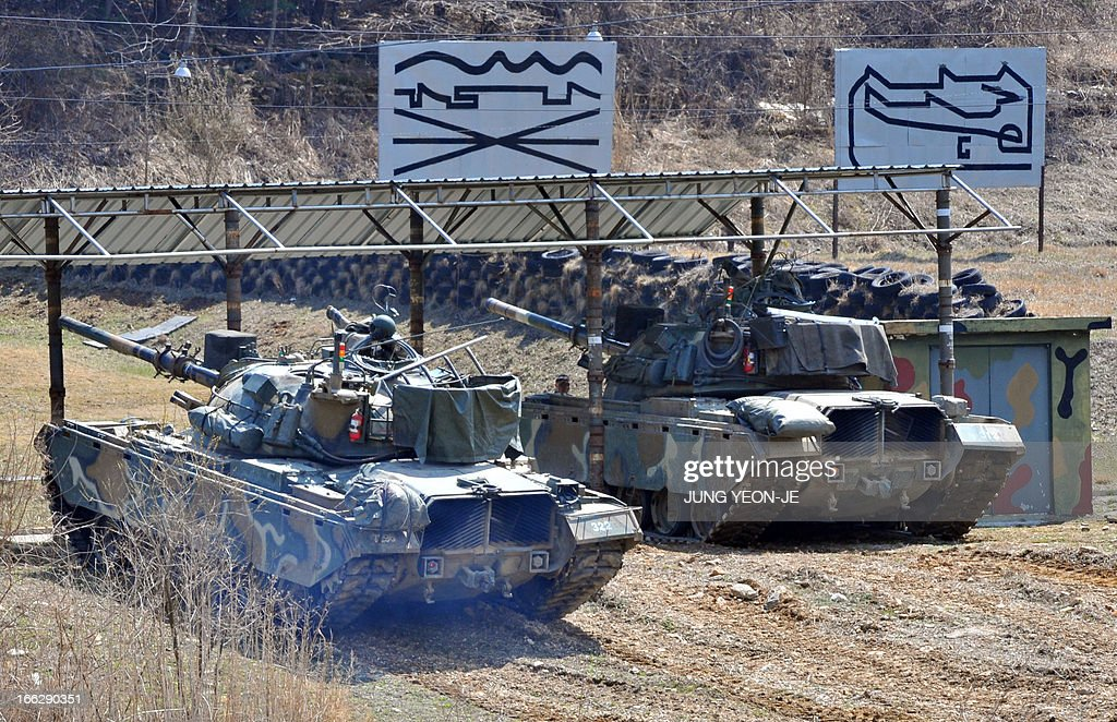 South Korean army tanks move at a shooting range in the border city of Paju on April 11, 2013. North Korea kept the world on edge on April 11, over an expected missile launch while turning its own energies to celebrating leaders past and present amid soaring tensions on the Korean peninsula.