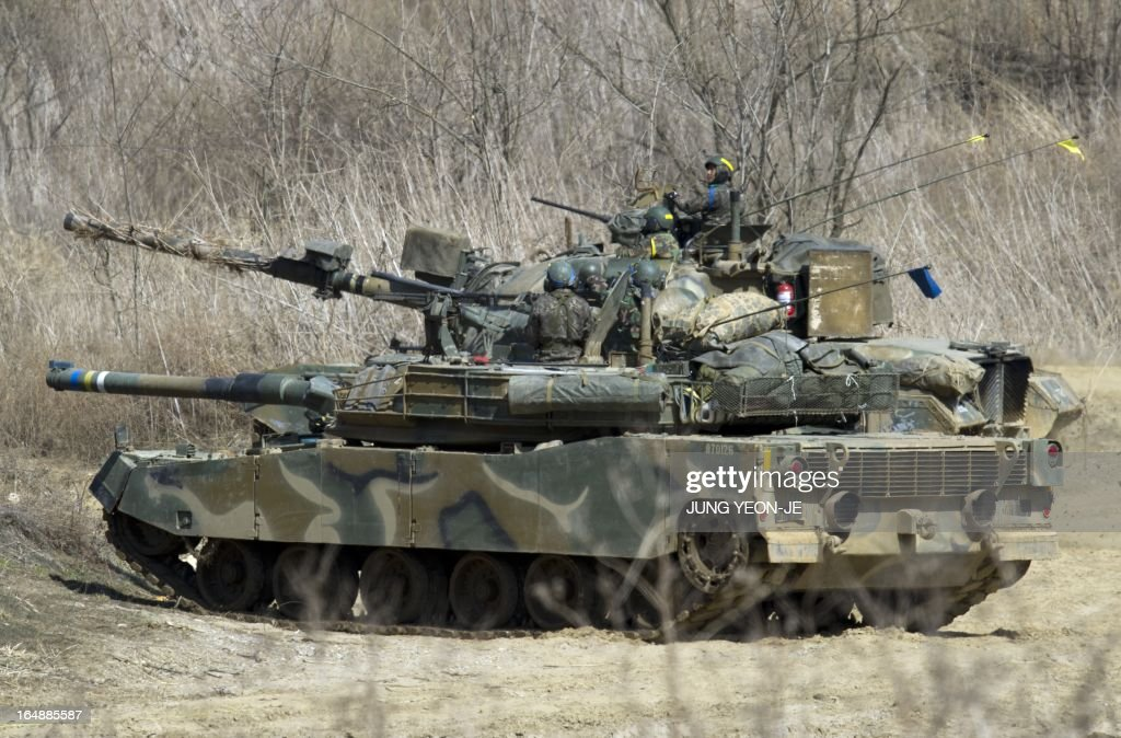 South Korean army tanks participate in a drill at a military training field in the border city of Paju on March 29, 2013. North Korean leader Kim Jong-Un on March 29, ordered missile units to prepare to strike US mainland and military bases, vowing to 'settle accounts' after US stealth bombers flew over South Korea.
