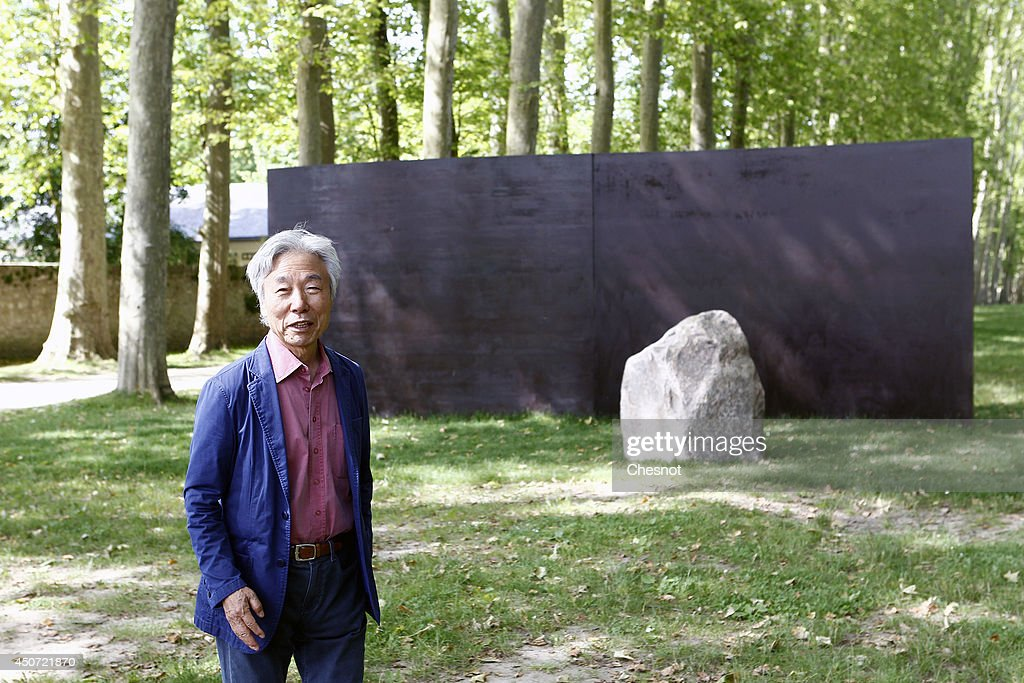 South Korean artist <a gi-track='captionPersonalityLinkClicked' href=/galleries/search?phrase=Lee+Ufan&family=editorial&specificpeople=8945134 ng-click='$event.stopPropagation()'>Lee Ufan</a> poses beside one of his artworks entitled 'Dialogue Z ' during the exhibition '<a gi-track='captionPersonalityLinkClicked' href=/galleries/search?phrase=Lee+Ufan&family=editorial&specificpeople=8945134 ng-click='$event.stopPropagation()'>Lee Ufan</a> Versailles' at the Chateau de Versailles on June 16, 2014 in Versailles, France. Painter and sculptor <a gi-track='captionPersonalityLinkClicked' href=/galleries/search?phrase=Lee+Ufan&family=editorial&specificpeople=8945134 ng-click='$event.stopPropagation()'>Lee Ufan</a>, 77, has created a variety of artworks made of stone and steel for an exhibition at the Chateau de Versailles, outside Paris. The exhibition opens from June 17 until November 02, 2014 at the Chateau de Versailles.