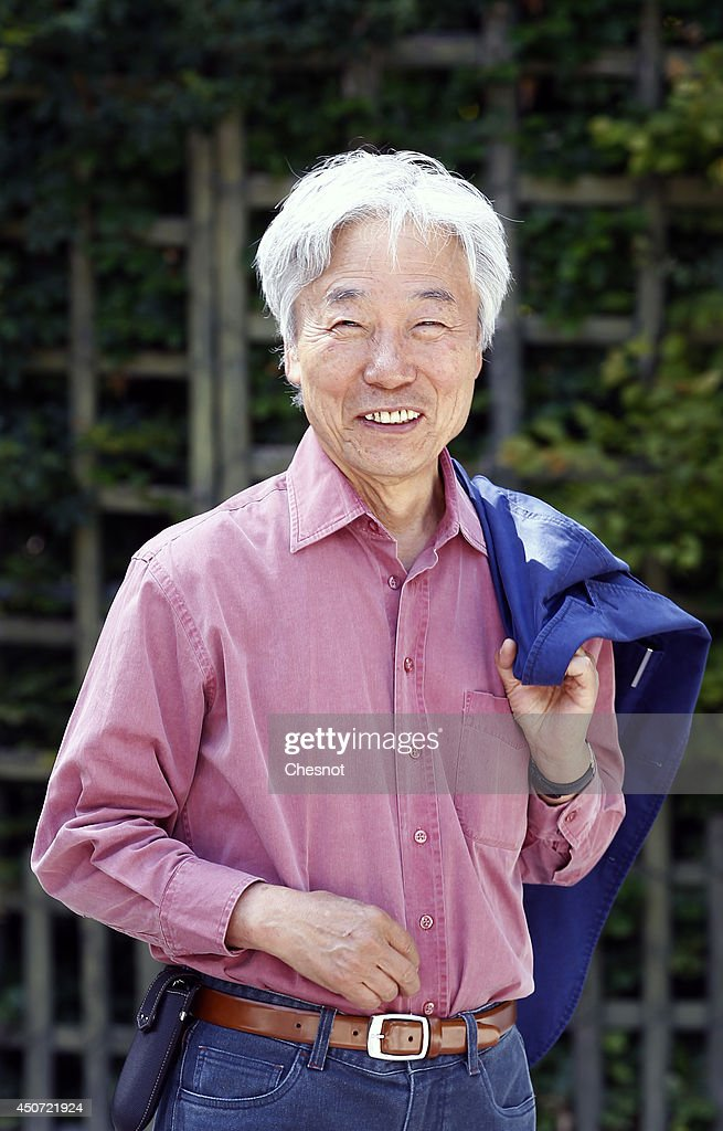 South Korean artist <a gi-track='captionPersonalityLinkClicked' href=/galleries/search?phrase=Lee+Ufan&family=editorial&specificpeople=8945134 ng-click='$event.stopPropagation()'>Lee Ufan</a> poses in the Versailles garden during the exhibition '<a gi-track='captionPersonalityLinkClicked' href=/galleries/search?phrase=Lee+Ufan&family=editorial&specificpeople=8945134 ng-click='$event.stopPropagation()'>Lee Ufan</a> Versailles' at the Chateau de Versailles on June 16, 2014 in Versailles, France. Painter and sculptor <a gi-track='captionPersonalityLinkClicked' href=/galleries/search?phrase=Lee+Ufan&family=editorial&specificpeople=8945134 ng-click='$event.stopPropagation()'>Lee Ufan</a>, 77, has created a variety of artworks made of stone and steel for an exhibition at the Chateau de Versailles, outside Paris. The exhibition opens from June 17 until November 02, 2014 at the Chateau de Versailles.