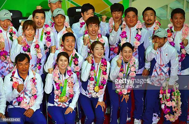South Korean athletes of the Rio Olympics pose for a photo call during a ceremony as they arrive at Incheon airport west of Seoul on August 24 2016...