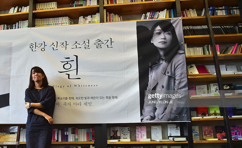 South Korean author Han Kang, who won the Man Booker International Prize last week, poses for a photo during her first press conference since the award, in Seoul on May 24, 2016. Han Kang was humble about her latest achievement, saying she wants to continue writing 'as if nothing had happened.' / AFP / JUNG