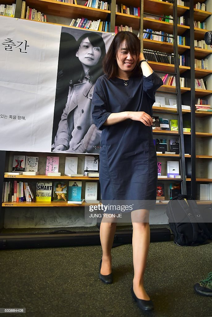 South Korean author Han Kang, who won the Man Booker International Prize last week, leaves after her first press conference since the award, in Seoul on May 24, 2016. Han Kang was humble about her latest achievement, saying she wants to continue writing 'as if nothing had happened.' / AFP / JUNG