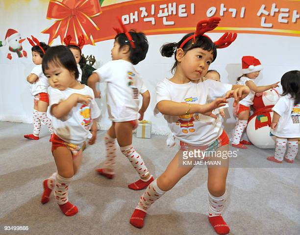 South Korean babies wearing diapers perform during a dance contest at a hotel in Seoul on November 30 2009 The contest was sponsored by a diaper...