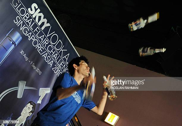 South Korean bartender Kim Dea Min exhibits his skill by juggling bottles of vodka during a regional flair bartending competition at the Skyy Vodka...