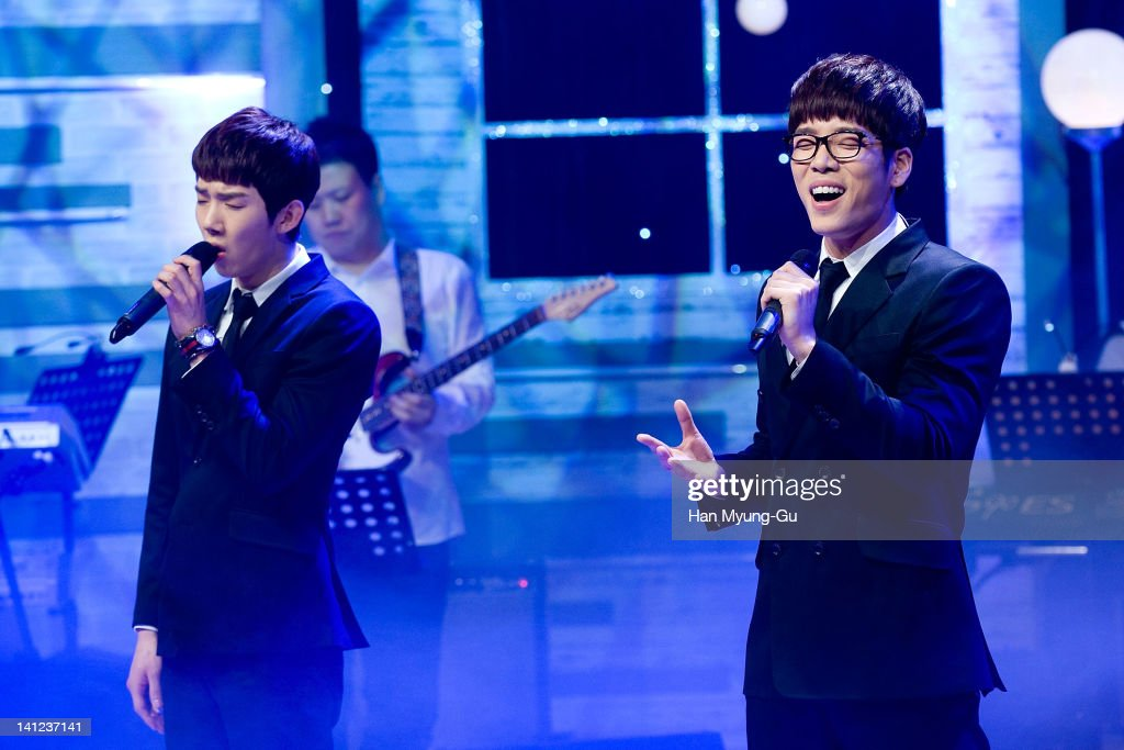 South Korean boy band Jo Kwon and Changmin of 2AM performs live during their 2th mini album 'FScott Fitzgerald's Way Of Love' Showcase event at Ilchi...