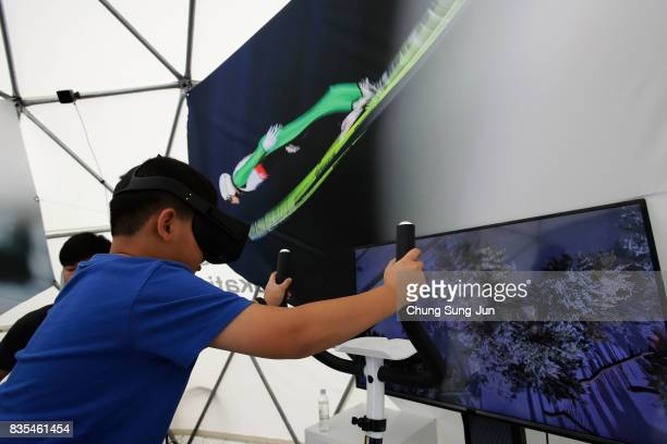 South Korean boy enjoy the PyeongChang Winter Olympics booth next to 'Bobsleigh In the City' event on August 19 2017 in Seoul South Korea The...
