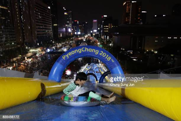 South Korean boy slides down on an inflatable ring during the 'Bobsleigh In the City' on August 19 2017 in Seoul South Korea The 22metrehigh...