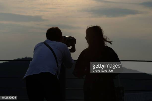 South Korean boy uses binoculars to look over the North Korea at the Imjingak observation post on September 3 2017 in Paju South Korea South Korean...