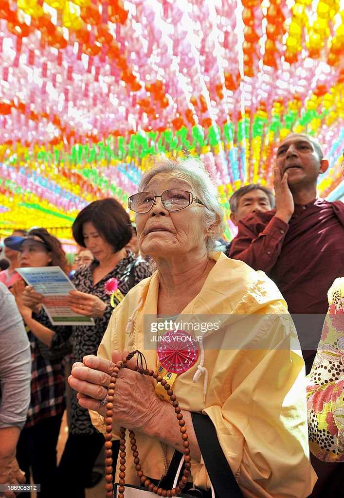 South Korean Buddhist followers pray under rows of lotus lanterns during a ceremony to celebrate the birthday of Buddha at Jogye temple in Seoul on May 17, 2013. Buddhism is one of South Korea's largest and most active religions with millions of followers. Although the exact date is unknown, Buddha's official birthday is celebrated on April 8th of the lunar calendar in South Korea.