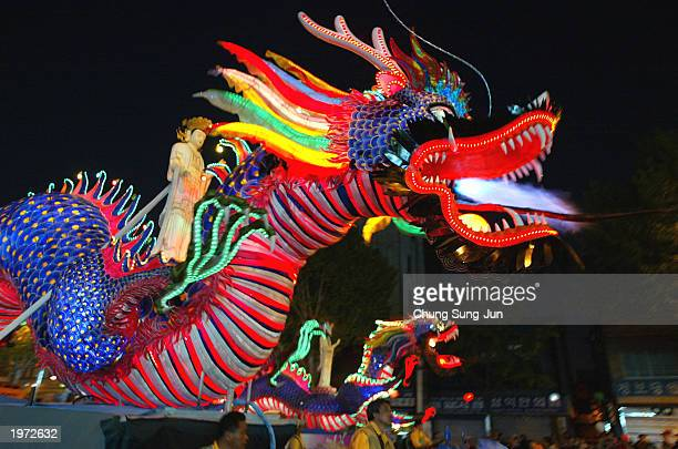 South Korean Buddhists carry a dragon lantern as they celebrate the upcoming birthday of Buddha May 4 2003 in Seoul South Korea According to...