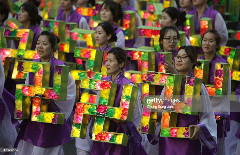 South Korean Buddhists carry colorful lanterns as they celebrate the forthcoming birthday of Buddha on May 16 2015 in Seoul South Korea As the exact...