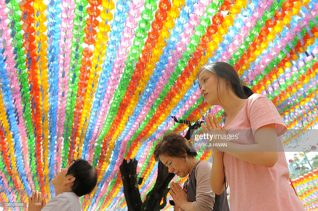 South Korean Buddhists pray during a service to celebrate the 2,554th birthday of Buddha at Chogye temple in Seoul on May 21, 2010. South Korean Buddhists hold several events to celebrate Buddha's birthday.