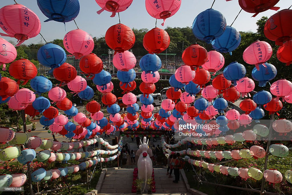 South Korean Buddhists walk under colourful lanterns as they celebrate the forthcoming birthday of Buddha at Dongguk University on May 11, 2013 in Seoul, South Korea. Buddha was born approximately 2,557 years ago, and although the exact date is unknown, Buddha's official birthday is celebrated on the full moon in May in South Korea, which is on May 17 this year.
