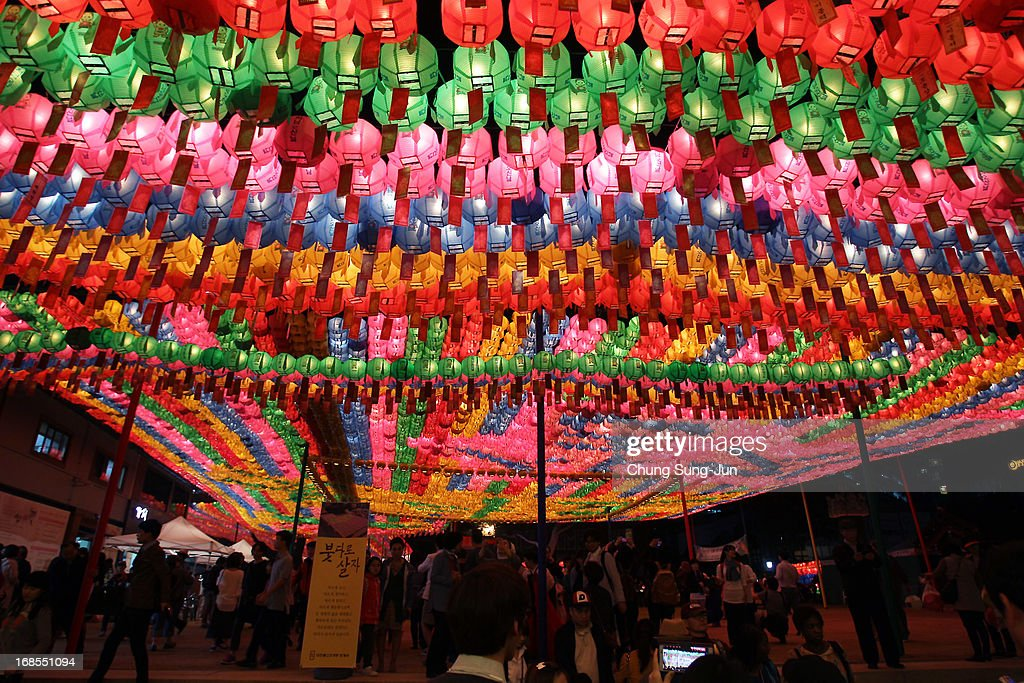 South Korean Buddhists walk under colourful lanterns as they celebrate the forthcoming birthday of Buddha at Chogey temple on May 11, 2013 in Seoul, South Korea. Buddha was born approximately 2,557 years ago, and although the exact date is unknown, Buddha's official birthday is celebrated on the full moon in May in South Korea, which is on May 17 this year.