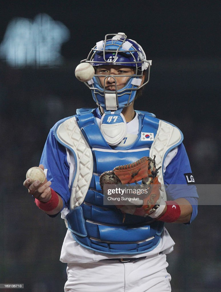 South Korean catcher Kang Min-Ho changes the ball in the fifth inning during the World Baseball Classic First Round Group B match between Chinese Taipei and South Korea at Intercontinental Baseball Stadium on March 5, 2013 in Taichung, Taiwan.
