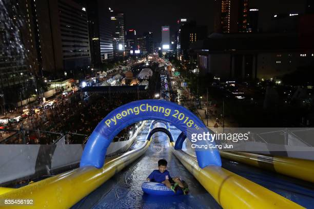 South Korean child slides down on an inflatable ring during the 'Bobsleigh In the City' on August 19 2017 in Seoul South Korea The 22metrehigh...
