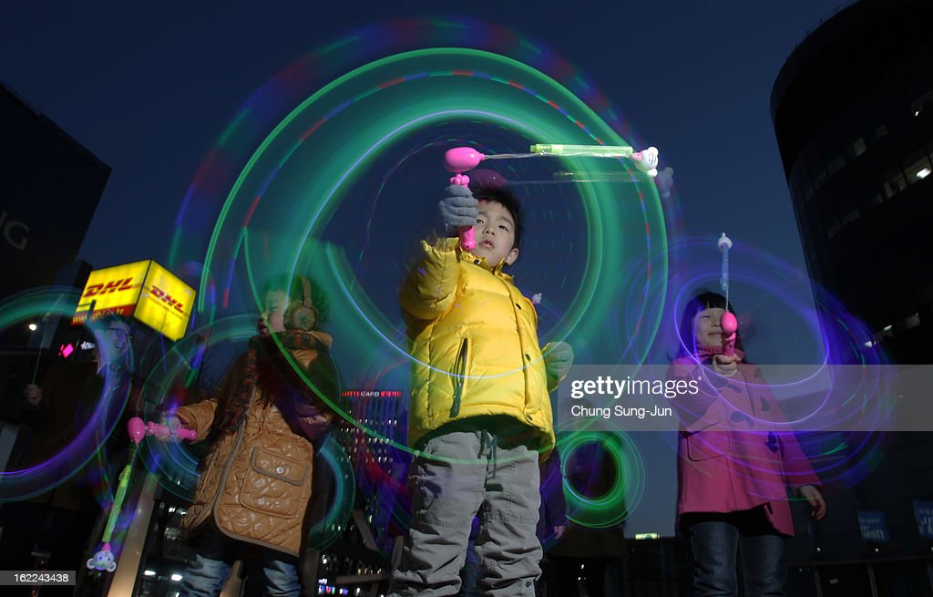 South Korean children spin illuminated sticks during 'Cyber Jwibulnoli' at Everland on February 21, 2013 in Seoul, South Korea. Jwibulnoli is originally played on the first full moon of the lunar year, that is February 25 this year.