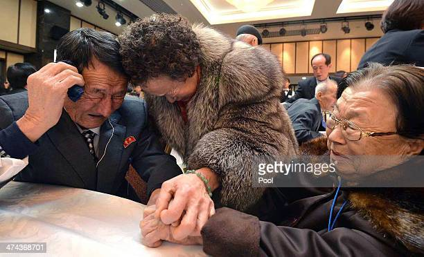 South Korean Cho DoSoon and Cho OhSoon meet their North Korean brother Cho WonJe during a family reunion after being separated for 60 years on...