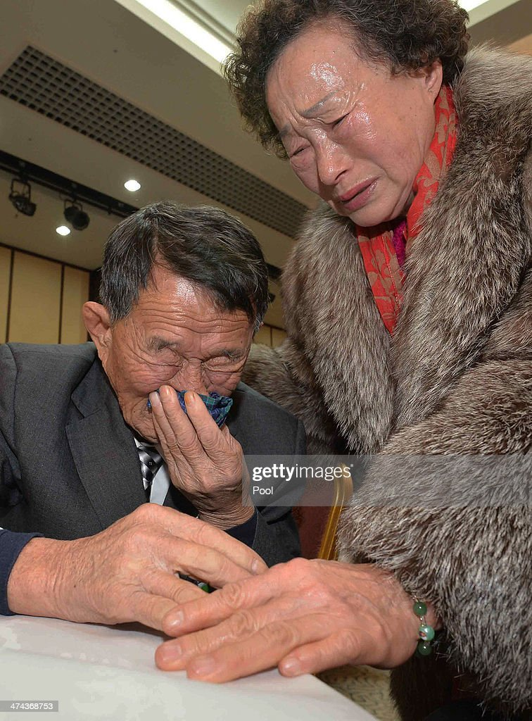 South Korean Cho Do-Soon (R) meets with her North Korean older brother Cho Won-Je (L),82, during a family reunion after being separated for 60 years on February 23, 2014 in Mount Kumgang, North Korea. The program, which allows reunions of family members separated by the 1950-53 Korean war, is a result of recent agreement between Koreas which had been suspended since 2010.
