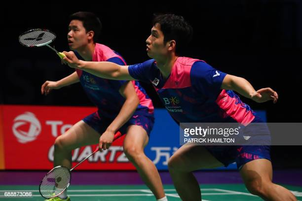 South Korean Choi Solgyu hits a return during the men's doubles Sudirman Cup match with partner Seung Jae Seo against Bodin Issara and Dechapol...