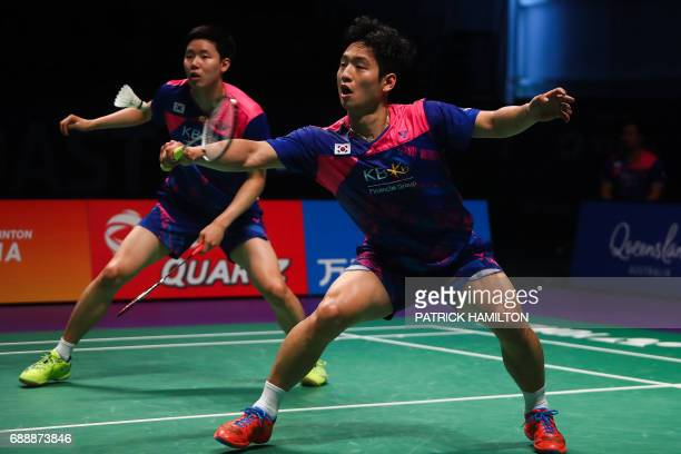 South Korean Choi Solgyu hits a return during the men's doubles Sudirman Cup match with Seung Jae Seo against Bodin Issara and Dechapol Puavaranukroh...