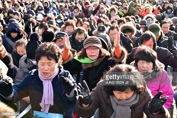 South Korean Christians pray during a New Year's service for the Korean peninsula's reunification and peace at the Imjingak peace park at the border...