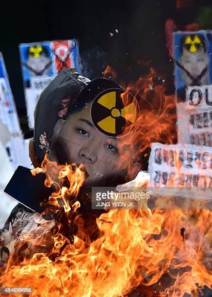 South Korean conservative activists burn an effigy of North Korean leader Kim JongUn during a rally denouncing North Korea's rocket firing in Seoul...