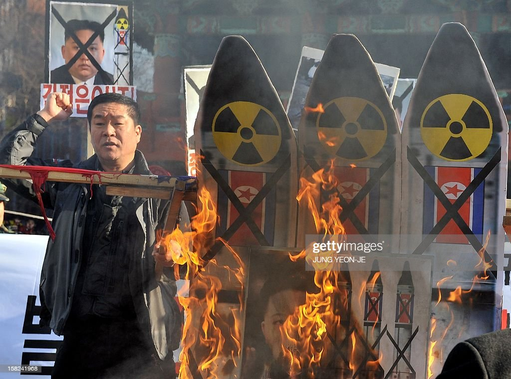 South Korean conservative activists burn anti-North Korean placards during a protest denouncing North Korea's rocket launch, in Seoul on December 12, 2012. North Korea's rocket launch is evidence of a new ballistic missile capability that sharply raises the stakes over Pyongyang's nuclear programme and poses a direct threat to the United States, analysts say.